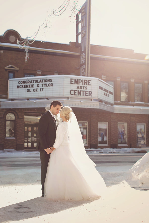 Bride and Groom in Front of Theatre | A Sparking Winter Wedding | Dana Widman Photography | Kate Aspen