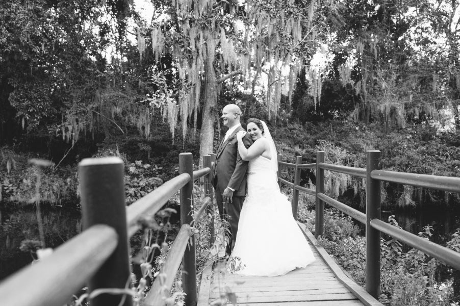 Bride and Groom on Bridge | Plantation Wedding in Charleston | Riverland Studios