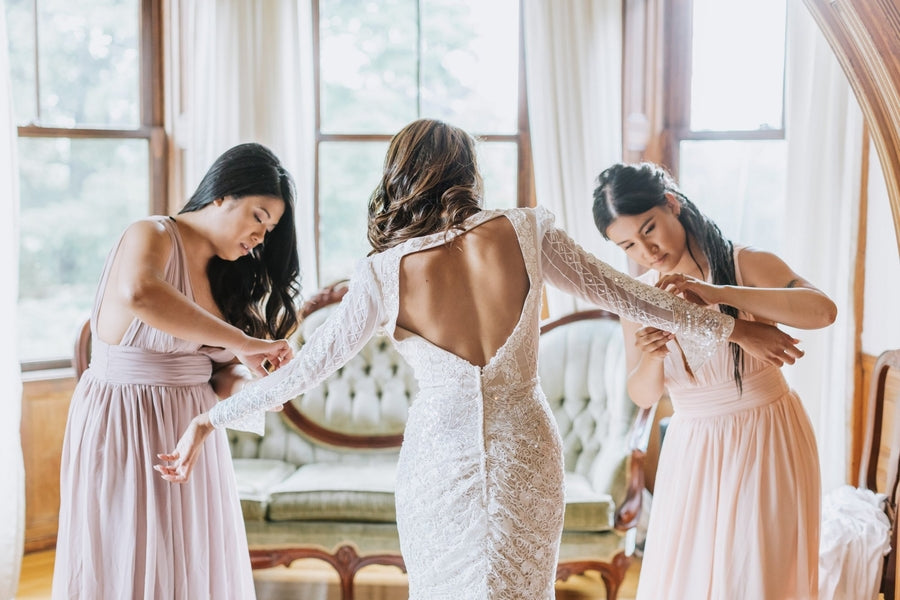 Bridesmaids Helping Bride Get Ready | A Dazzling Doughnut Wedding | Kate Aspen