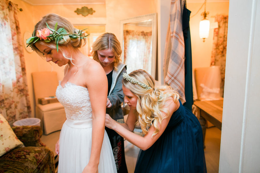 Bridesmaids Helping Bride Get Ready | A Flowery Fall Wedding | Kate Aspen