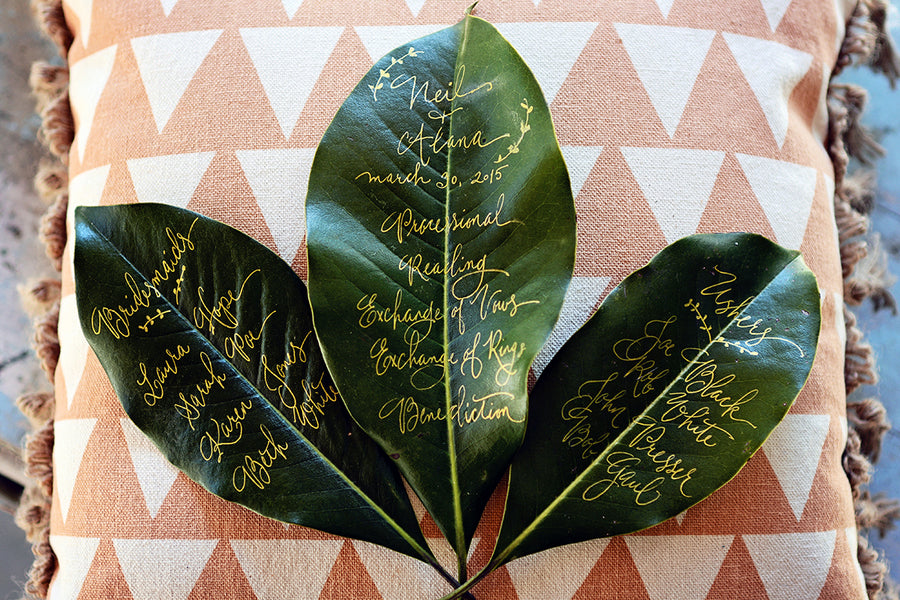 Bohemian wedding program on magnolia leaves | Catrina Earls Photography