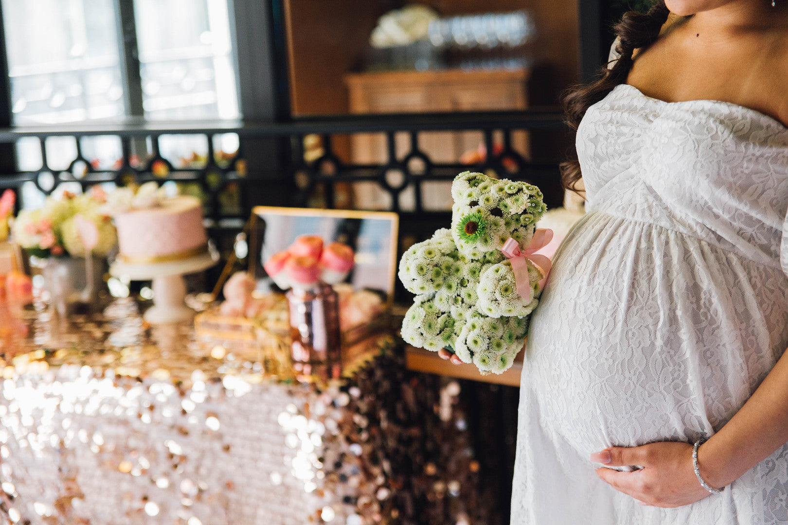 Mom-To-Be Holding Floral Bear | A Luxe Circus Baby Shower | Kate Aspen