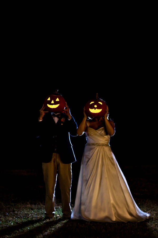 Couple Holding Pumpkins | Falling in Love With This Halloween Wedding | Kate Aspen