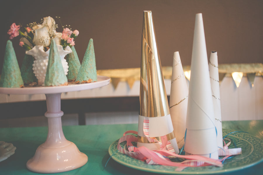 Unicorn Horn Party Hats | Shabby Chic Unicorn Birthday Party captured by Heather Lynn Photographie and styled by Mariah Rainier Style. Pretty party sweets by Turquoise & Pink. See the full party featured on the Kate Aspen blog!