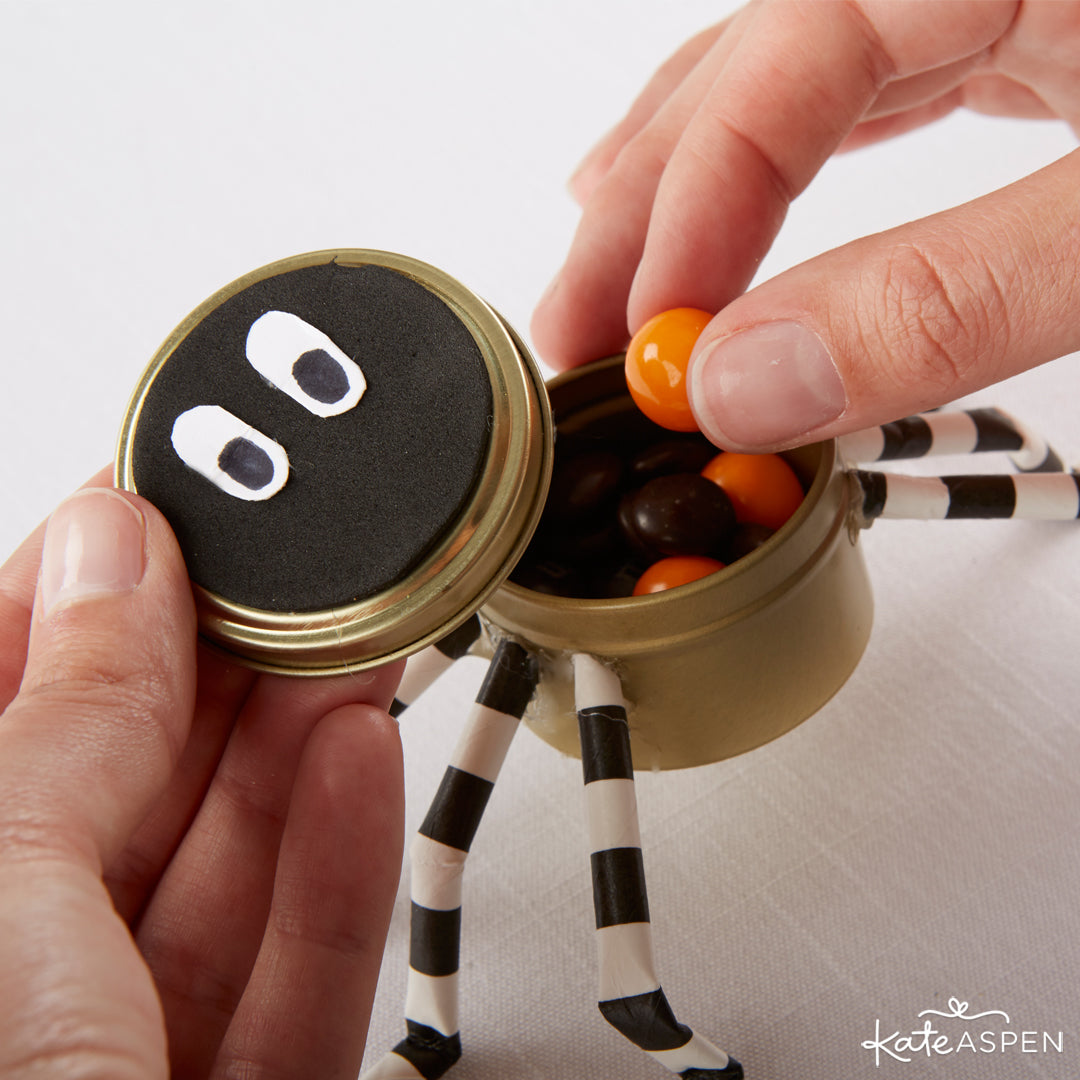 Putting the Candy in the Tin | DIY Halloween Spider Favor Tins | Kate Aspen