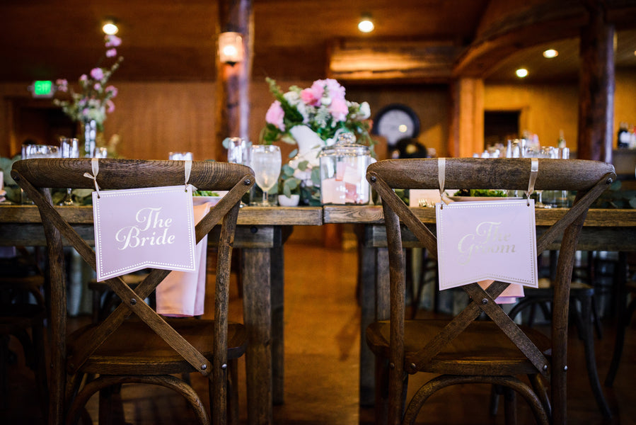Bride and Groom Chair Signs | A Snowy Spring Wedding | Kate Aspen