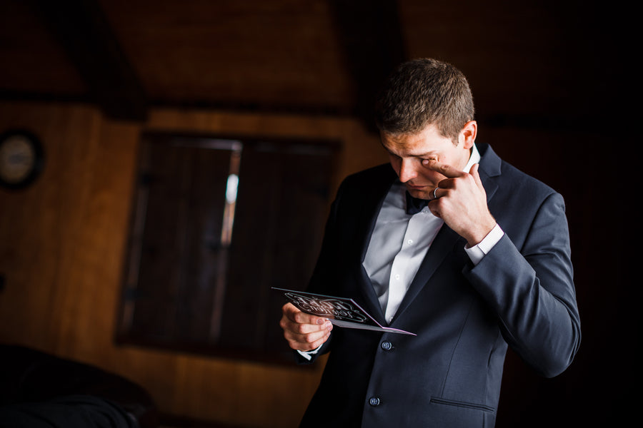 Groom Reading Letter | A Snowy Spring Wedding | Kate Aspen