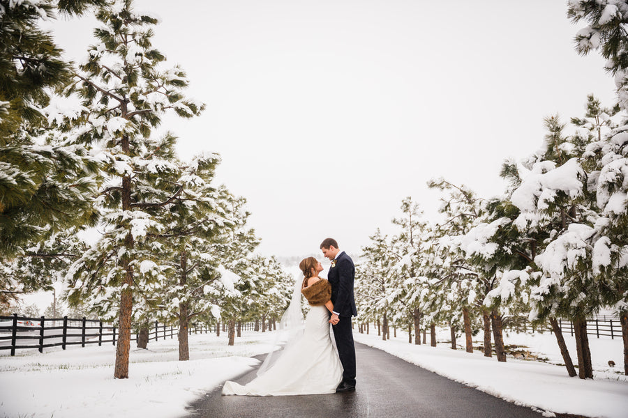 Bride and Groom in Snow | A Snowy Spring Wedding | Kate Aspen