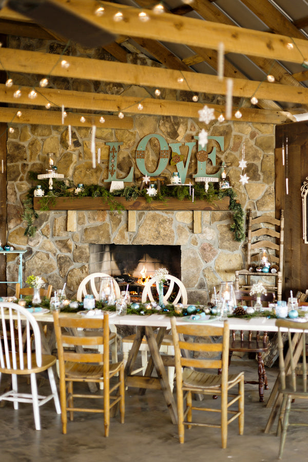 Country Chic White & Blue Winter Wedding | Andie Freeman Photography | Kate Aspen | Barn Wedding | Winter Wedding | Wedding Reception Decor | Estate Tables | Pine cones | Ornaments | Mantel Decor