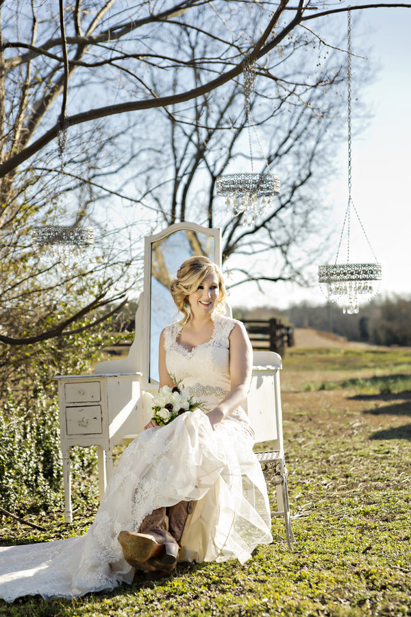Country Chic White & Blue Winter Wedding | Andie Freeman Photography | Kate Aspen | Barn Wedding | Winter Wedding | Lace Wedding Gown | Messy Bun | Bride in Boots