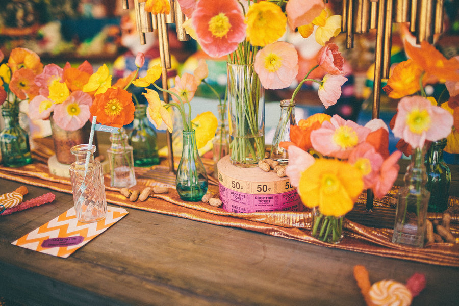 Bright poppies and stacks of tickets as centerpieces | Photograhpy: Prue Franzmann Photography | Styling: Enchanted Empire