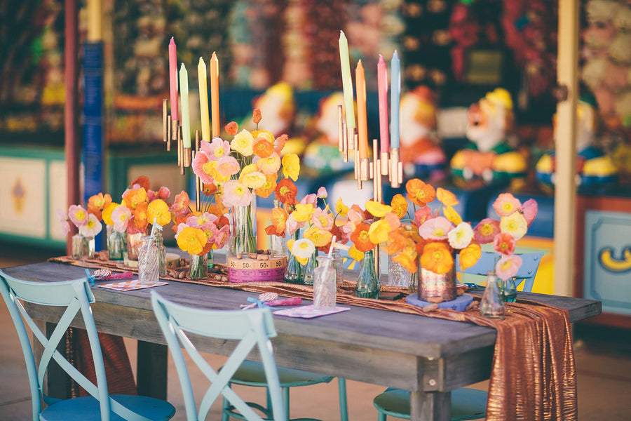 Bright orange, yellow and pink poppies on table | Photograhpy: Prue Franzmann Photography | Styling: Enchanted Empire