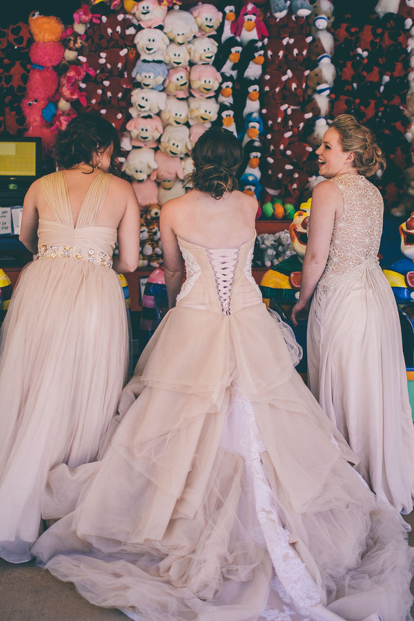 Bride and bridesmaids playing carnival games | Photograhpy: Prue Franzmann Photography | Styling: Enchanted Empire