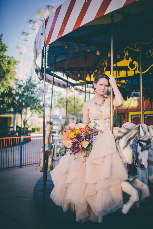Bride on carousel at amusement park | Photograhpy: Prue Franzmann Photography | Styling: Enchanted Empire