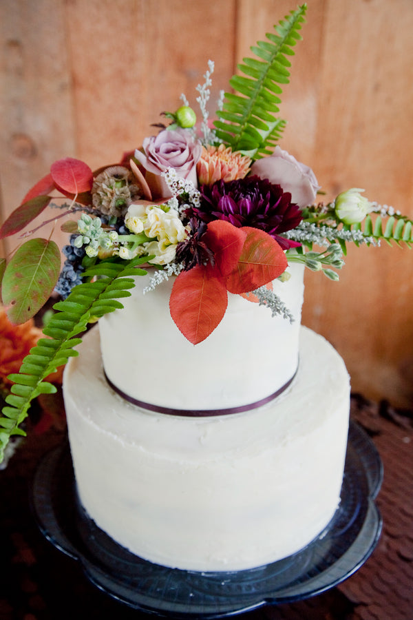 Fall Wedding Cake Topped With Flowers, Ferns and Leaves |  Tana Photography LLC