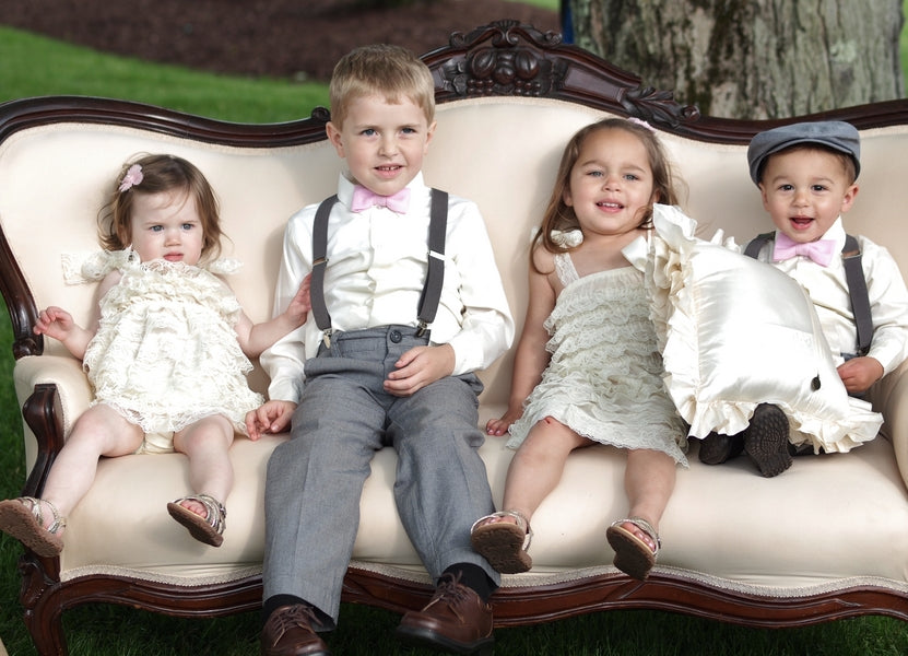 Sweet Flower Girls and Ring Bearers on Sofa | Laura Dee Photography