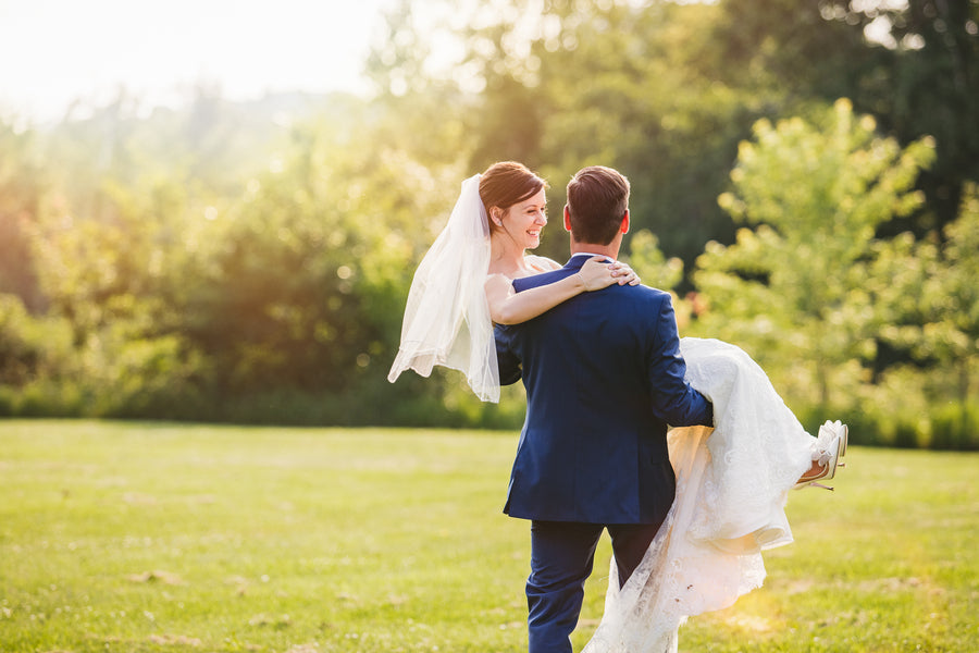 Groom Carrying Bride | A Happy and Bright Garden Wedding | Kate Aspen