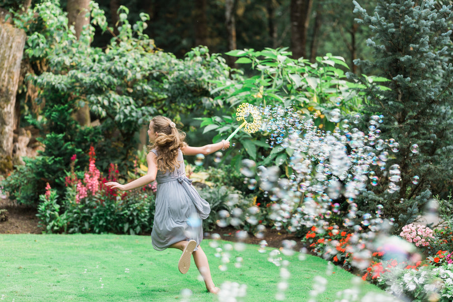 Girl Playing With Bubbles | Blissful Garden Wedding Details | B. Jones Photography