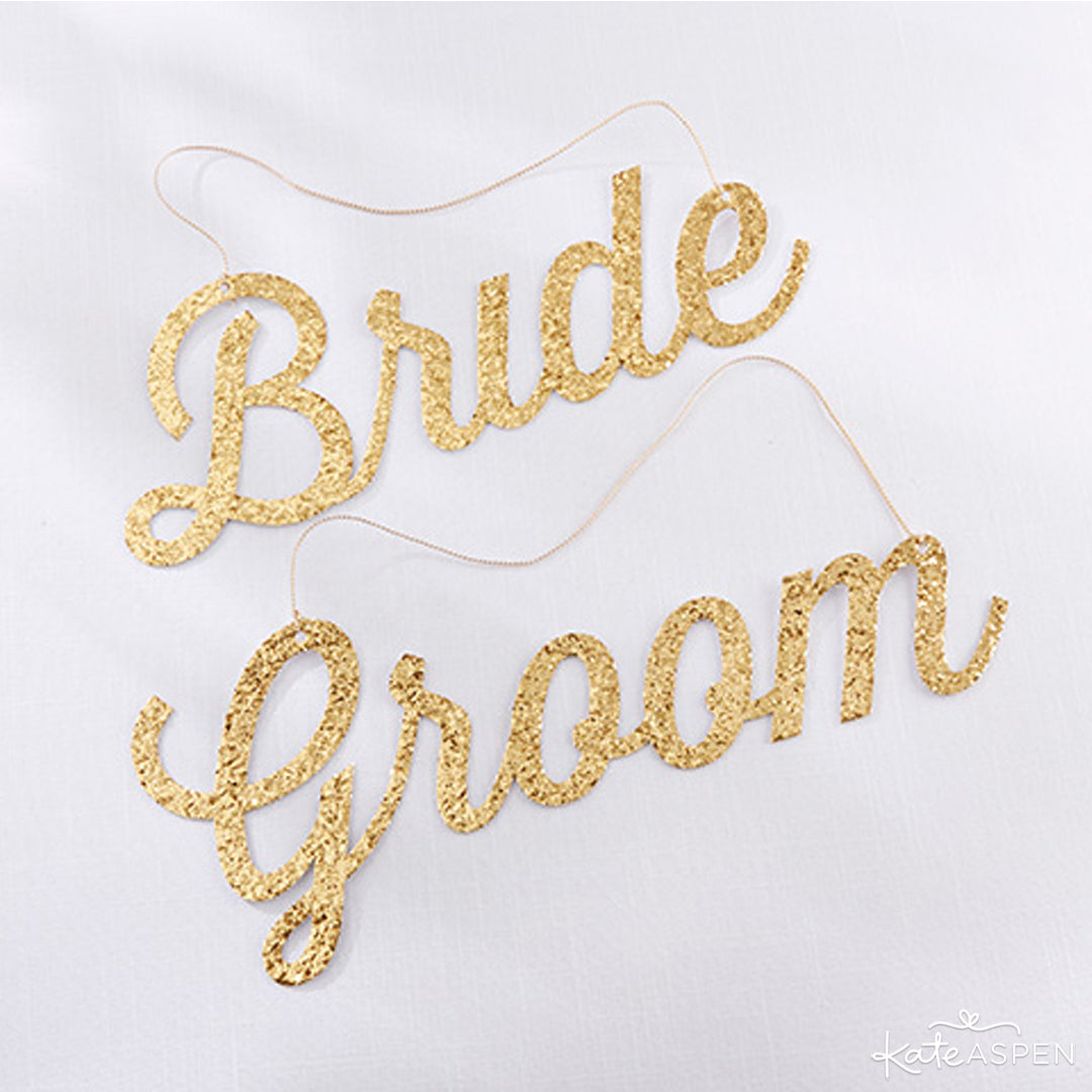 Gold Glitter Bride and Groom Signs | Kate Aspen