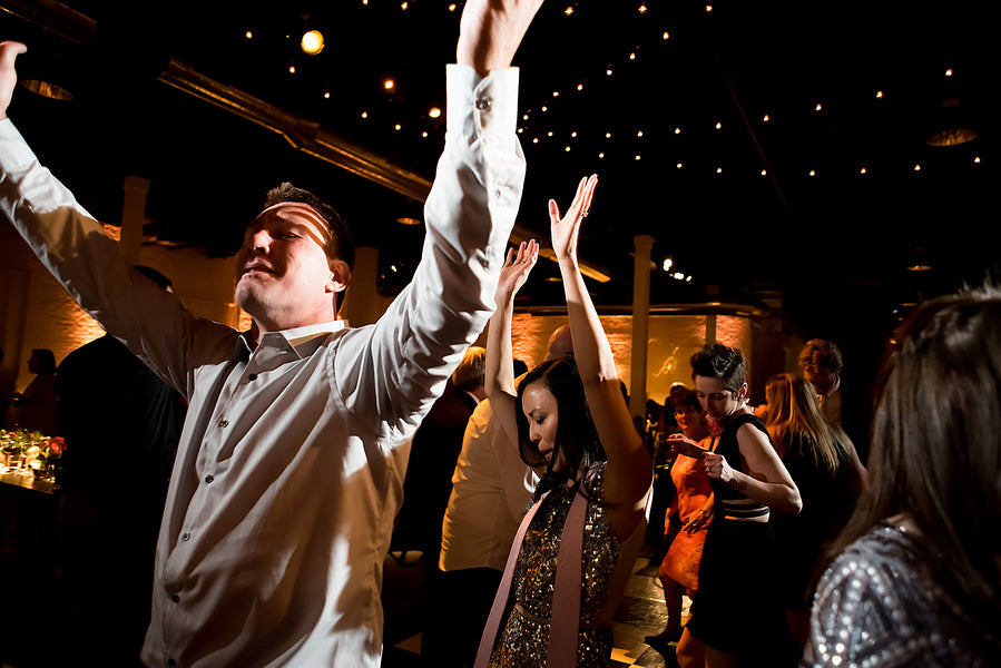Guests Dancing | An Unforgettable Night Wedding in the City | Kate Aspen