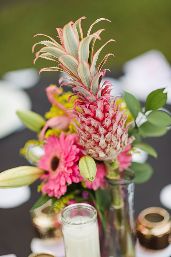 Mini pink pineapples create unique centerpieces for a retro engagement party | Two Prince Bakery Theater | Marc Edwards Photographs