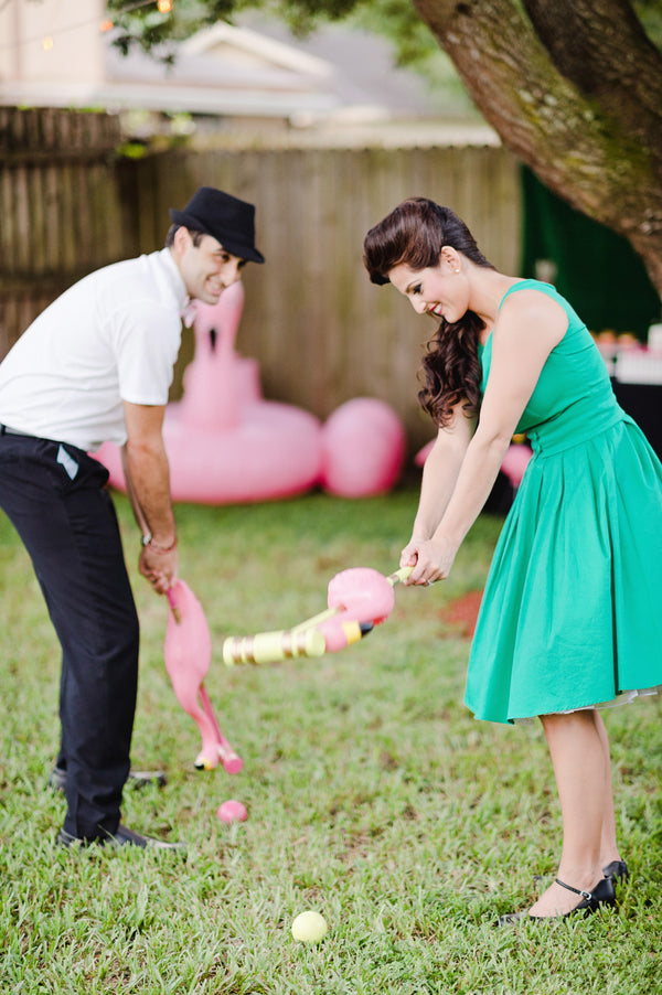 Flamingo croquet is a fun lawn game for a flamingo themed party! | A Retro Flamingo Engagement Party | Two Prince Bakery Theater | Marc Edwards Photographs
