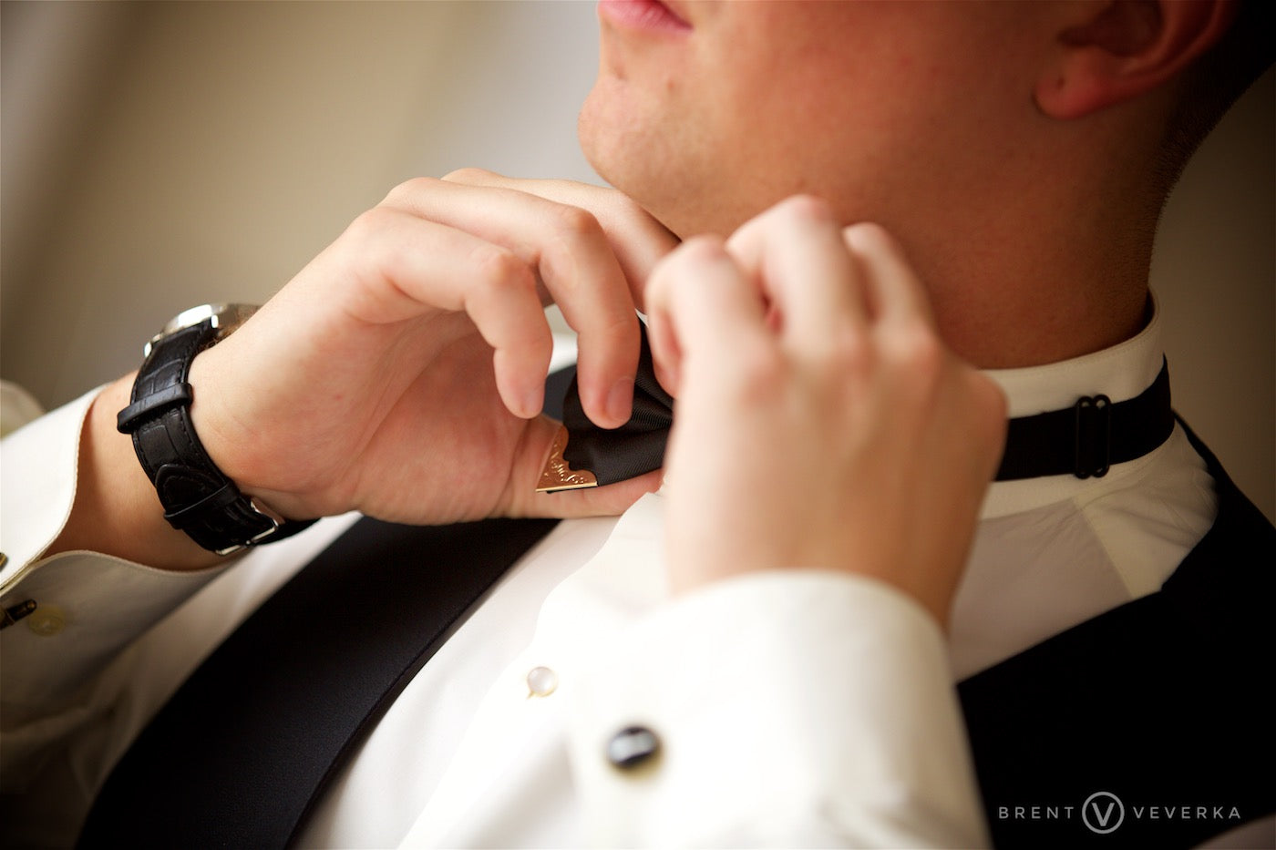 Groom Putting On Tie | Glam Speakeasy Wedding | Brent Veverka Media