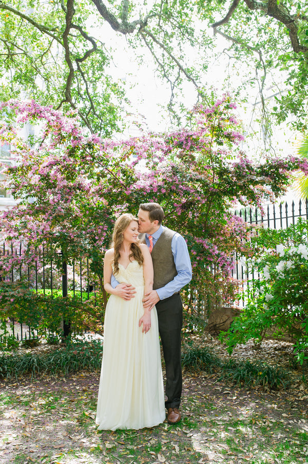 Grom Kissing Bride | Peachy Pink Wedding in Historic Charleston | Priscilla Thomas Photography