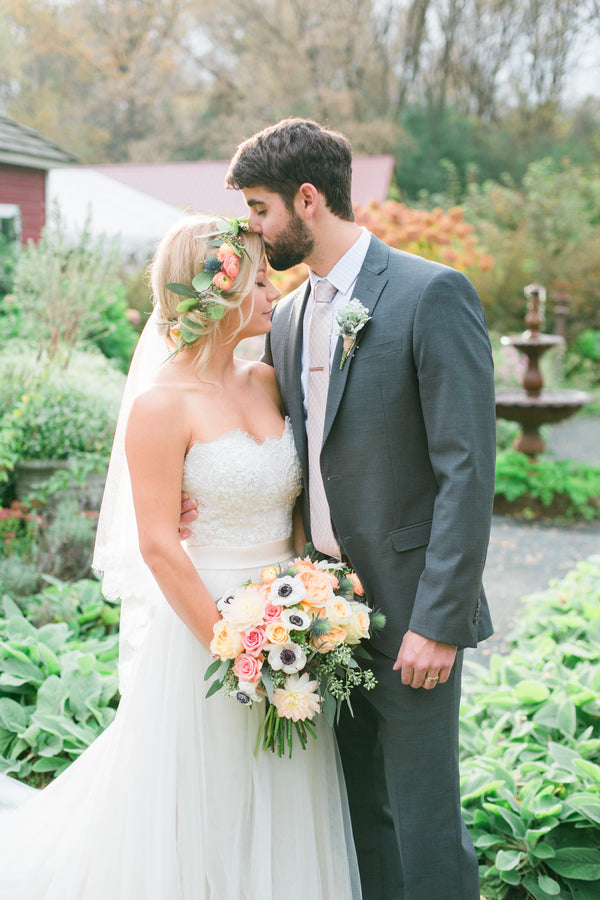 Groom Kissing Brides Forehead | A Flowery Fall Wedding | Kate Aspen