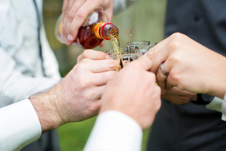 Groom and Groomsmen Take A Drink | Whimsical Rustic Barn Wedding | McKenzie Stewart Weddings