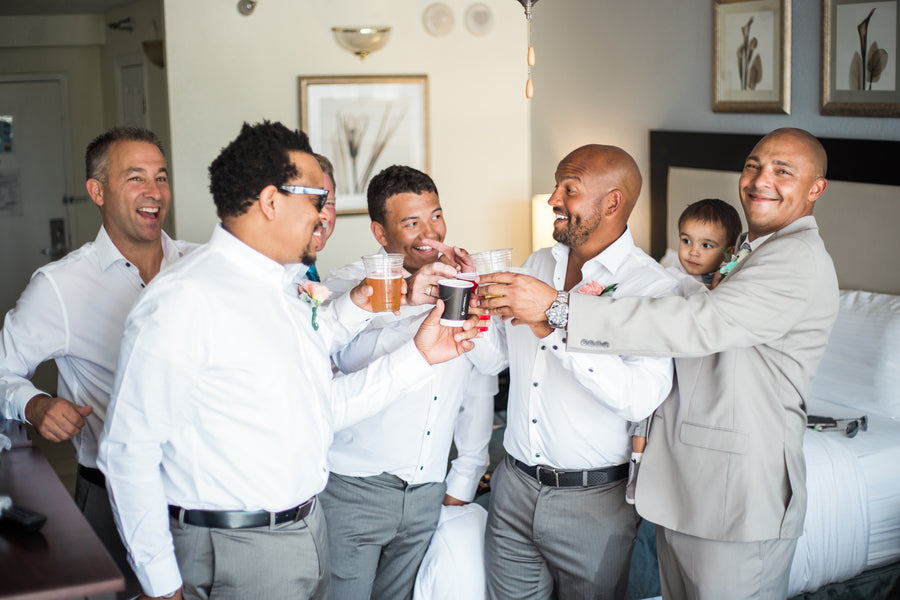Groomsmen Drinking | Kennedy Grace Photography | Tips for the Perfect Beach Wedding | Kate Aspen