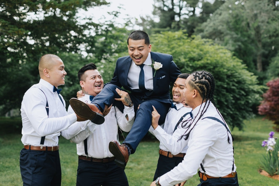 Groomsmen Picking Up Groom | A Dazzling Doughnut Wedding | Kate Aspen