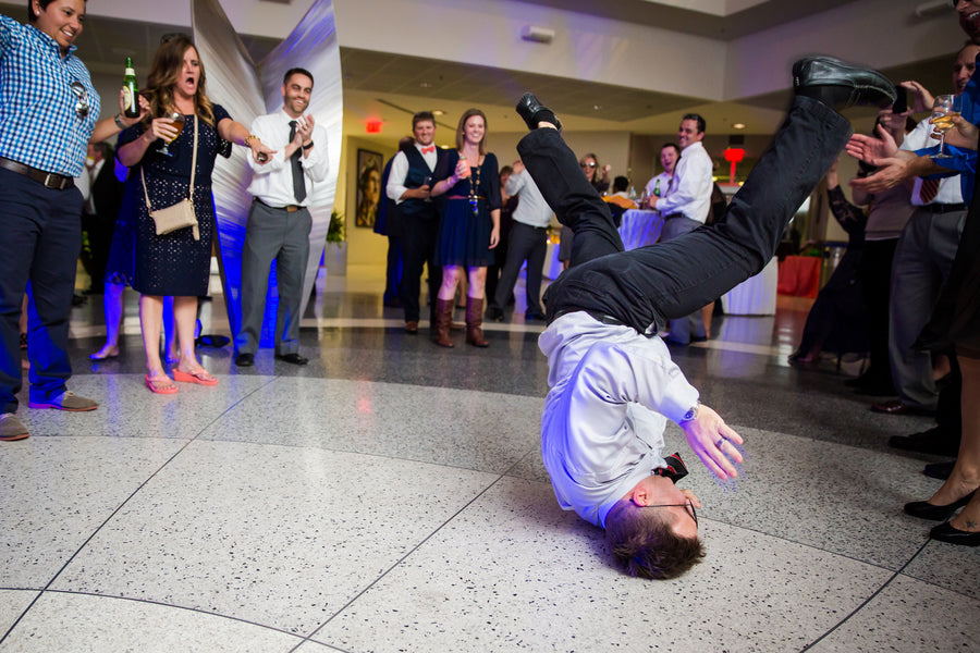 Guest Breakdancing At Reception | Aviation Themed Wedding | Red Bridge Photography