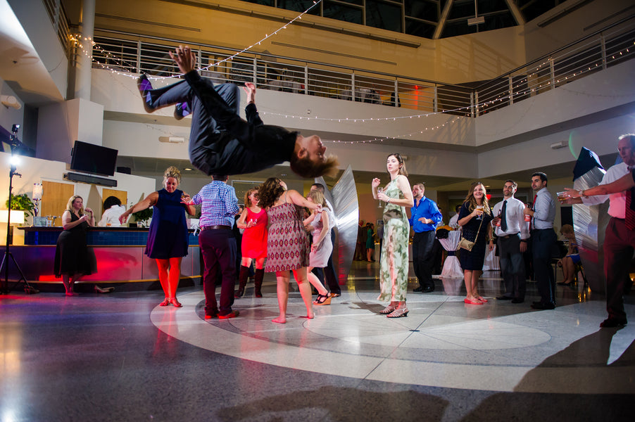 Guests Dancing At Reception | Aviation Themed Wedding | Red Bridge Photography