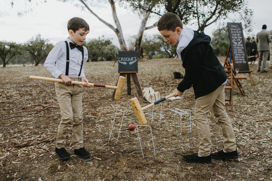 Kids Playing Croquet | A Farmhouse Chic Wedding | Kate Aspen