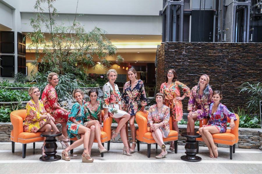 Bridesmaids and Bride in Colorful Floral Robes | Elizabeth Burgi Photography