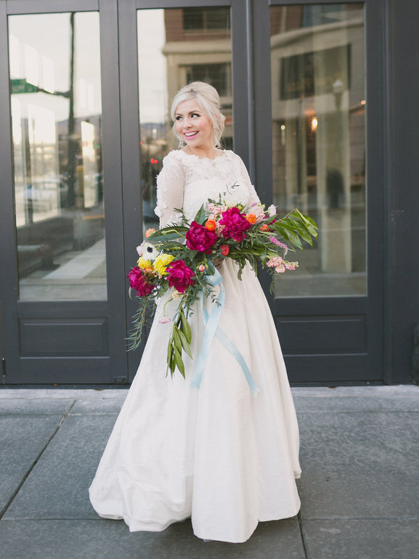 Bride with giant bouquet | Copyright Ampersand Studios 2014