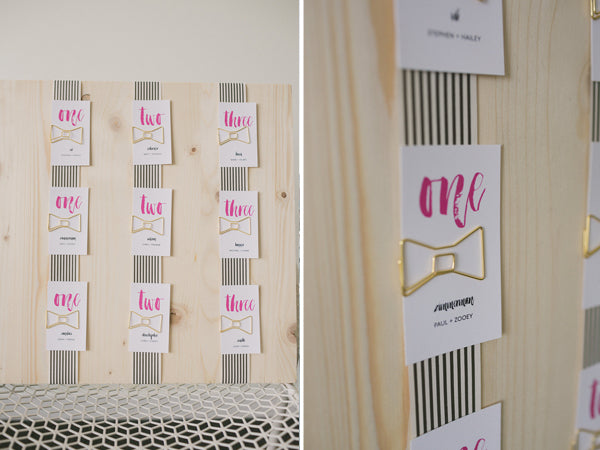 black and white striped escort card display | Copyright Ampersand Studios 2014