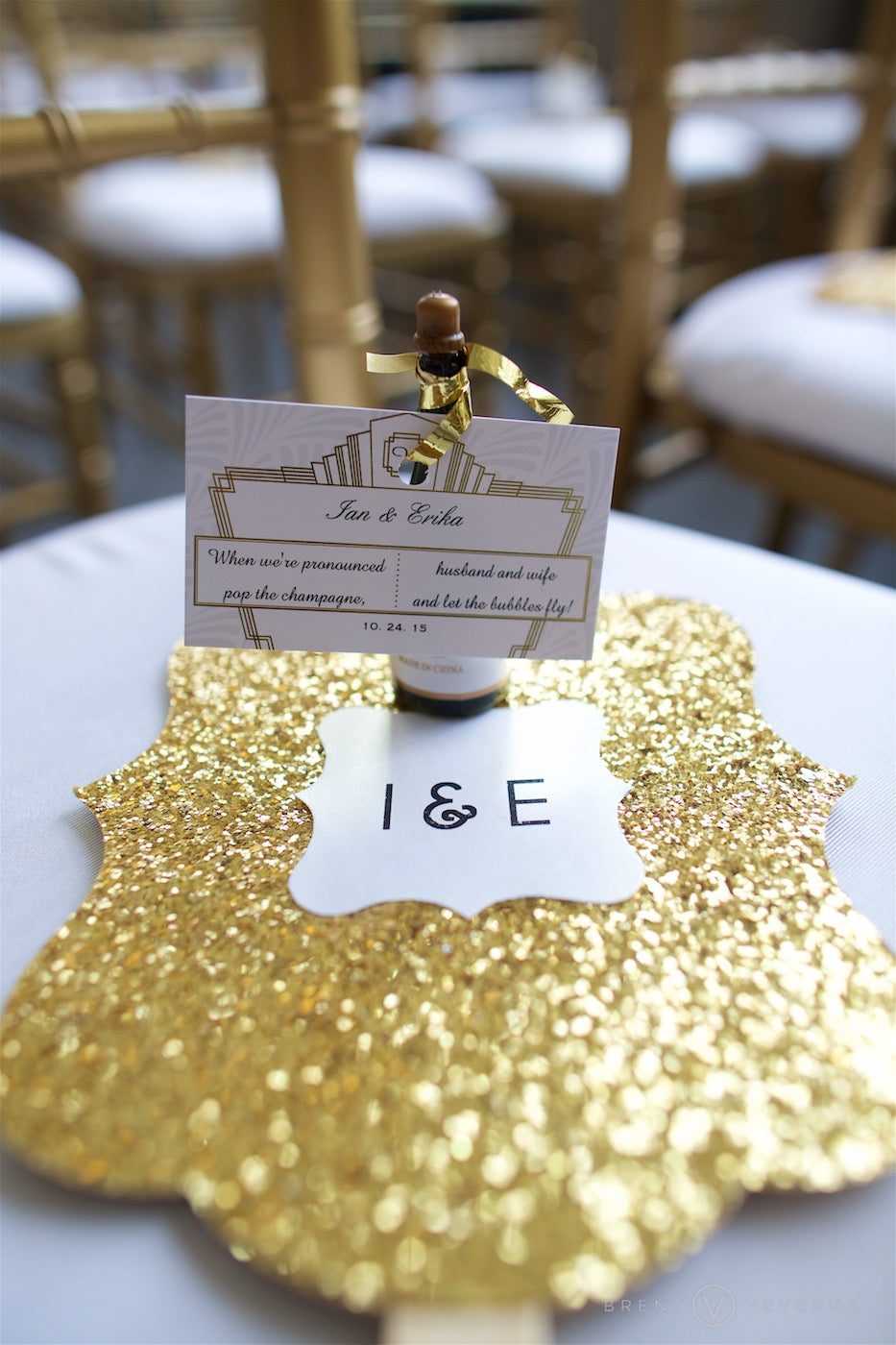 Kate Aspen Gold Glitter Fan and Champagne Bottle Bubbles | Glam Speakeasy Wedding | Brent Veverka Media