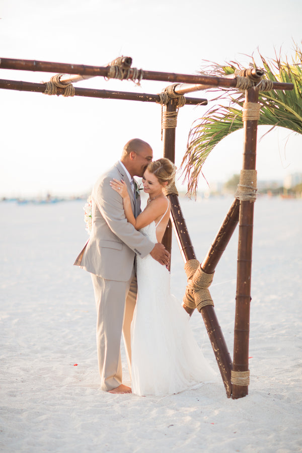 Kissing by the Beach | Kennedy Grace Photography | Tips for the Perfect Beach Wedding | Kate Aspen