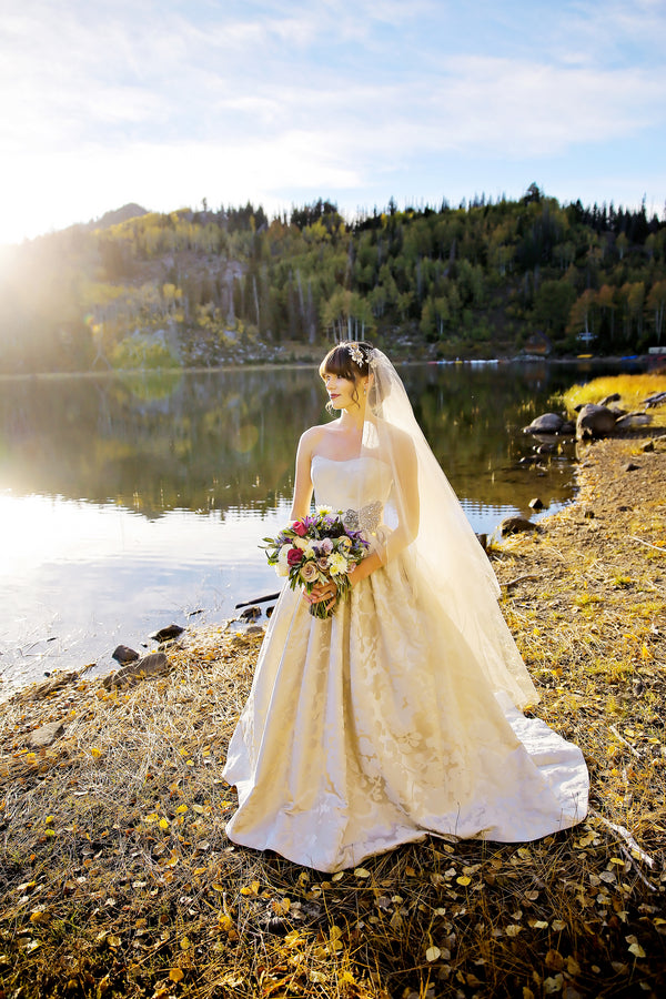 Bride posing in front of lake | Pepper Nix Photography