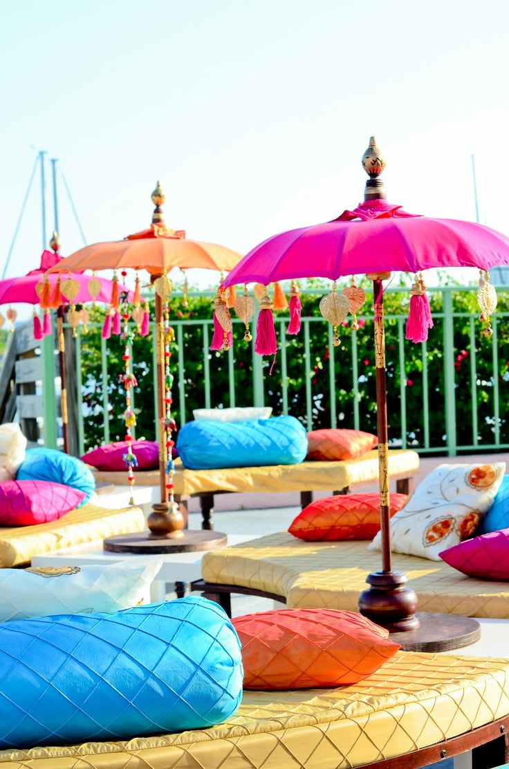 Mehndi party lounge seating with umbrellas| Suhaag Garden