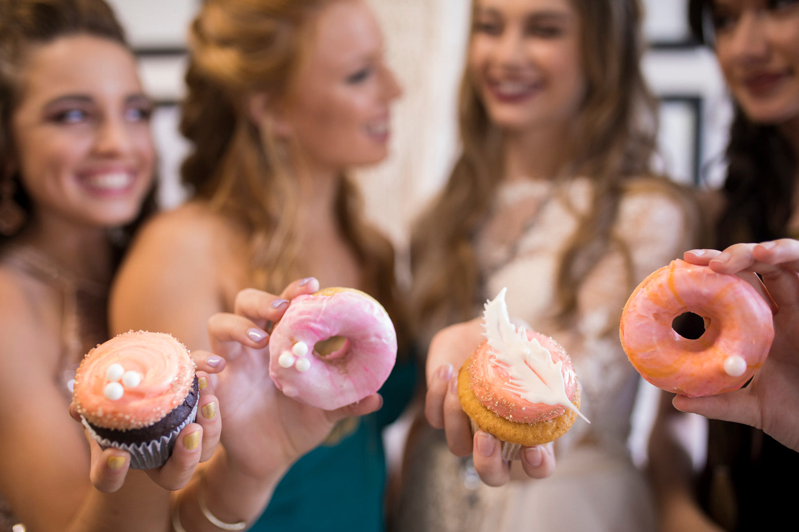 Girls Holding Donuts | A Super Bohemian Sweet 16 Soiree | Kate Aspen