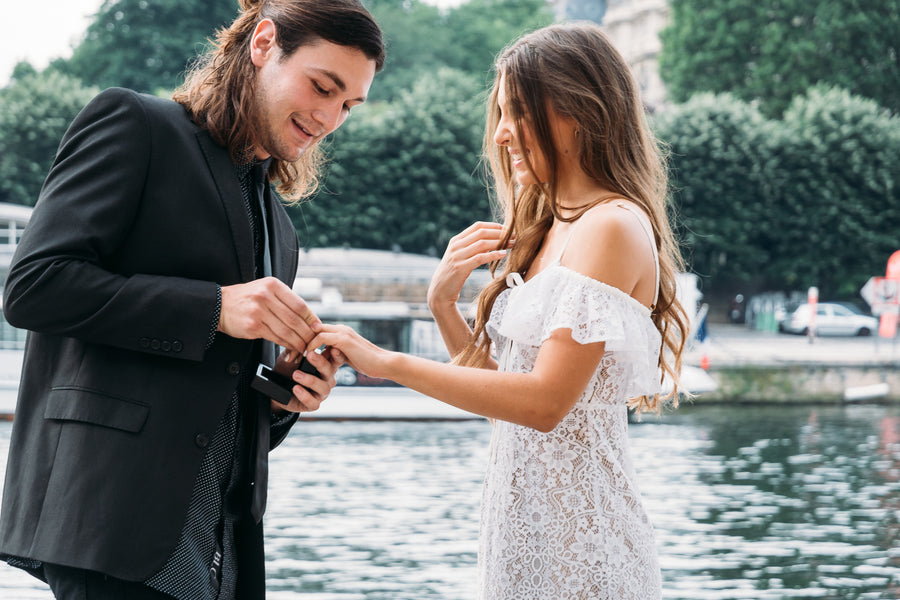 Man Putting Ring on Girl's Finger | 5 Unique and Adorable Engagements | Kate Aspen