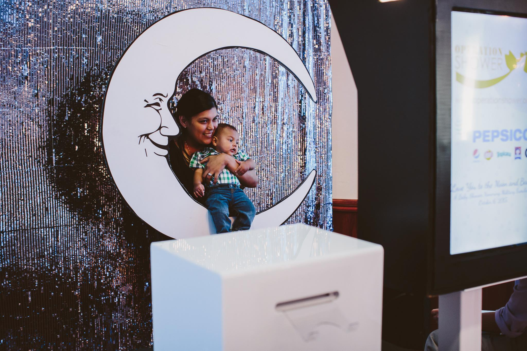 A Mom and Baby Pose in Photobooth | Mirage+Light Photography