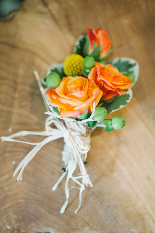 Orange and green boutonniere | Lemon Twist Images
