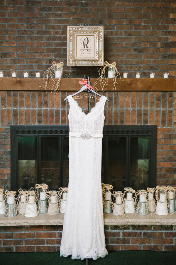 Bride's dress on hanger | Lemon Twist Images