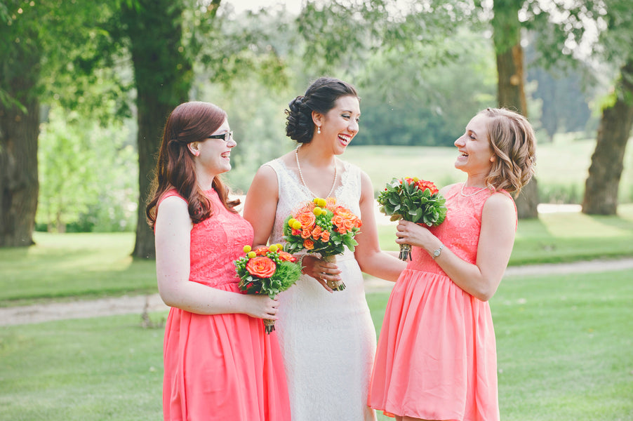 Bride with bridesmaids in coral dresses | Lemon Twist Images