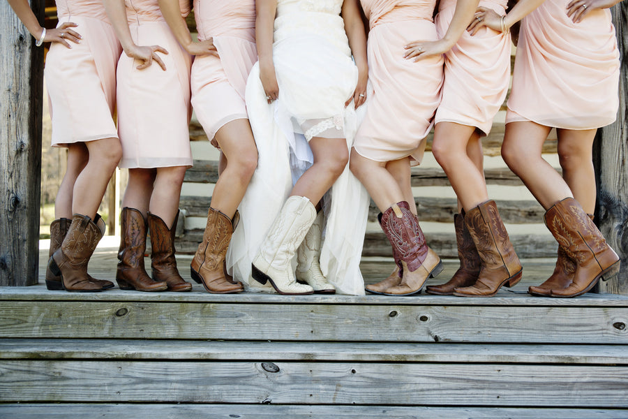 8 Must-Have Details For Your Rustic Chic Wedding - Kate Aspen Blog | Real Wedding designed by Jessie Patton of Southern Sophistication Designs and photographed by Andie Freeman Photography | Bridesmaids in boots