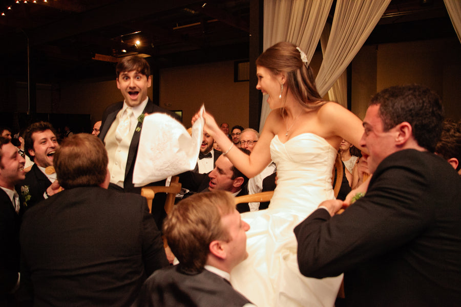 Bride and Groom Lifted in Chairs at Reception | Suburbanite Photography